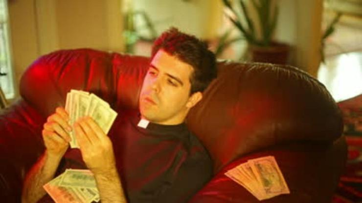 qqlSVFxQbaM25zJnPj6M_stock-footage-corrupt-priest-with-lots-of-money