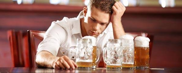 young-man-beer-glasses-595x240